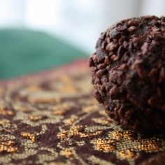 Raw Cacao truffles ~  Ingredients~  3/4 Cup Raw Cacao Powder (You may also use regular unsweetened Cocoa Powder)      1 1/2 Cups Pre-Soaked Cashews (soak in warm water roughly 2 hours)      3/4 Cup Raw Agave Nextar      1 tsp Vanilla Extract      1 tsp Orange Extract      1/2 tsp Salt      zest of 1 Orange      3/4 cup melted Virgin Coconut Oil      1 Cup (Or more) Raw Cacao Nibs