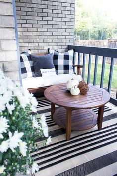 Welcome to a neutral Fall home tour with white pumpkins and plenty of cozy touches. fall porch, fall pillow, buffalo check pillows, velvet
