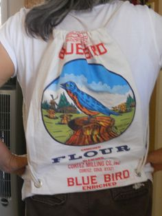 """I made this day-pack in a hour. I used 2 """"Blue Bird"""" flour sacks (since I have over 50+) 1 as a liner & the other as the cover, plus 2 2yds cords...It was a hit  at YW camp this summer!!"""