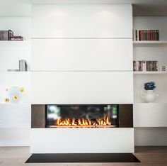 Radiating warmth and tranquility in this clean, contemporary lounge, our linear fireplace dances behind a pane of glass, reflecting light back into the room. Flanked by darker textured panels, it presents a stunning contrast to its bright white surroundings. Linear Fireplace, Modern Fireplace, Fireplace Wall, Wall Fireplaces, Contemporary Lounge, Radiators, Modern Luxury, Wall Design, Room