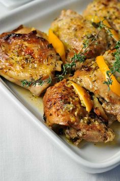 Easy Baked Lemon Chicken. Easy one-pot paleo dish that quickly became our family favourite. Fresh lemons, herbs and garlic make this easy Baked Lemon Chicken dish a quick weeknight meal and will have you dreaming of the sun-drenched Mediterranean.|www.flavourandsavour.com