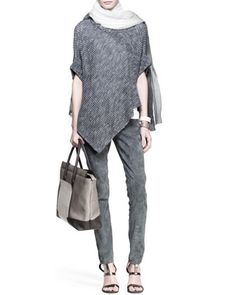 Boiled-Cashmere Ombre Scarf 1585$, Angled Knit Paillette Poncho 1290$, Flat Cotton Short-Sleeve Tee 440$, Slim Suede Ankle Pants 2545$ & Cuff Bracelets 245$ by Brunello Cucinelli at Neiman Marcus.