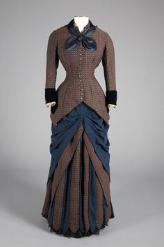 Day Dress Designer: Augustine Martin Medium: Wool, Silk, Metal Circa 1880 Country: France This dress bears the label of Augustine Martin and was purchased at the Philadelphia dry good emporium Darlington, Runk & Co. in 1880.