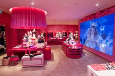 Victoria's Secret Store . . . My dream walk-in closet!! Hot pink + tufted velvet and big ass movie screen!! Ahhh I would never leave.