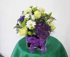 Purple Hydrangeas, Green Roses, and White Gerber Daisies are perfect in creating your color scheme.