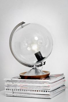 Globe lamp. Take the maps if a old globe and clean the class.