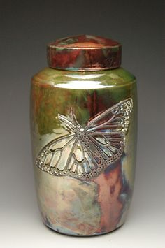 Butterfly Raku Urn. Ceramic raku fired cremation urn, made in the USA by hand with a unique flair. #butterflies #memorials