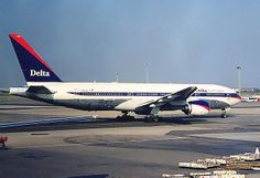 Delta Air Lines Boeing 777 (777-200), N862DA, in Ron Allen colors at JFK, New York, USA. (approx 2000)