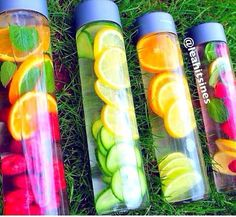 Use glass Voss bottles to refill with herbs & fruit