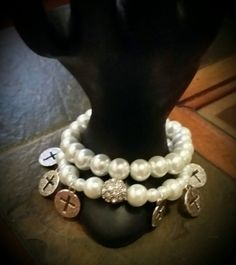 1 Single strand White Pearls bracelet. 1 Single strand White Pearls bracelet with 9 round charms/cross and large bling spacer. Special order, stunning.
