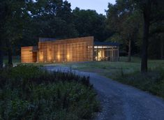 The Coffou Cottage sits in an L-shaped at the end of a private road.  This image shows how red cedar is utilized to create thin slats along the facade, as well as horizontal and vertical board-and-batten siding.