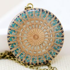 Vintage brass locket. This locket is sen breeze resin and turquoise resin and and navy blue resin colors. $69.99