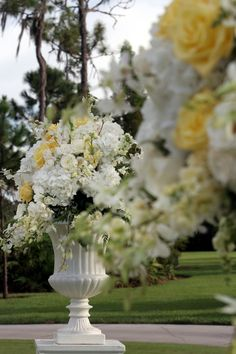 white yellow reception wedding flowers,  wedding decor, wedding flower centerpiece, wedding flower arrangement, add pic source on comment and we will update it. www.myfloweraffair.com can create this beautiful wedding flower look.