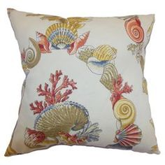 "Bring a touch of seaside flair to your living room or patio with this charming cotton pillow, showcasing a beautiful multicolor seashell and coral motif.    Product: PillowConstruction Material: Cotton and polyester cover and  poly fillColor: White and multiFeatures:  Insert includedSuitable for indoor and outdoor useDimensions: 16"" x 20"""