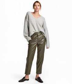 Khaki green. 5-pocket, ankle-length trousers in faux leather. Extended waistband tab with concealed button and zip fly with concealed hook-and-eye fasteners