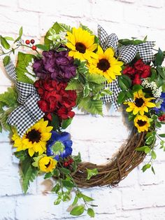 Sunflower Wreath, Sunflower Decor, Spring Wreath, Summer Wreath, Year Round Home Decor Add warmth and cheer to your home or work place with this vibrant grapevine wreath featuring bright and bold florals. Yellow sunflowers, purple and red hydrangea, purple clematis are nestled among airy
