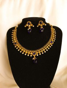 Indian Traditional ChandraMoti Pearl with Blue kundan studded Necklace with earrings.