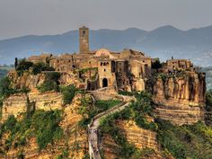 A private excursion from Rome Civitavecchia Port to Civita di Bagnoregio. Explore the beauty of central Italy on this private Civita di Bagnoregio excursion Toscana Italia, Italy Images, Italian Village, Walled City, Visit Italy, Day Tours, Abandoned Places, Abandoned Buildings, Italy Travel