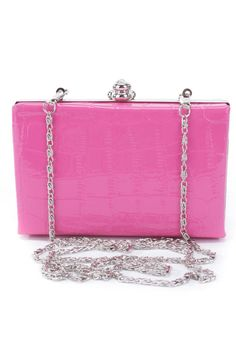 Perfect clutch for a girls night out it features; patent faux leather, reptile textured, removable chain, high polish snap closure. 5 1/2 inch width 3 1/2 inch length 2 inch depth.