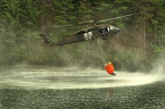 UH-60 Black Hawk helicopter dips a Bambi Bucket