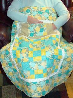Yellow and turquoise Lovie Lap Quilt with pockets. http://www.homesewnbycarolyn.com