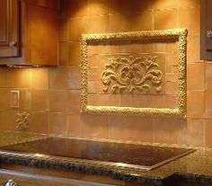 High relief tile backsplash to replace dated stainless in the kitchen.
