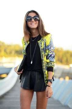 neon bomber jacket with tiger print + dark t-shirt & leather shorts