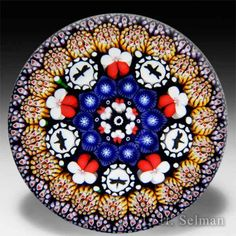 Mike Hunter 2015 close concentric millefiori with butterflies and pansies glass paperweight. by Twists Glass Studio