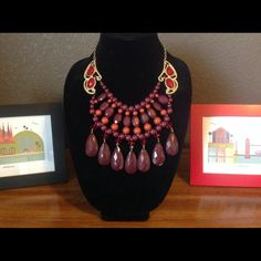 Tribal Princess Red Statement Necklace Gorgeous statement necklace with multiple layers and shades of red. Has gold tone frame and chain with basic adjustable clasp. Red plastic stones on frame. Has tear drop earrings for pierced ears. Fashion jewelry. Final price. Jewelry Necklaces