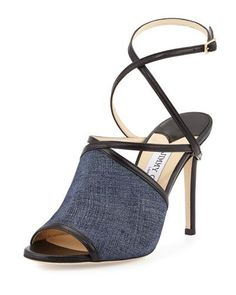 """Jimmy Choo denim-print leather sandal with napa trim. 4"""" stiletto heel. Open toe. Crisscross vamp. Adjustable crisscross ankle-wrap strap. Smooth outsole. """"Flora"""" is made in Italy."""