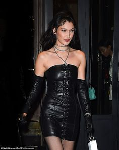 Lovely in leather: Bella Hadid slipped into one of her more daring ensembles to date during Paris Fashion Week on Saturday evening, exuding sex appeal in a lace-up leather minidress