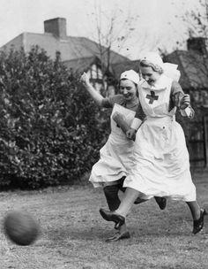 Nurses playing football, England, 1939