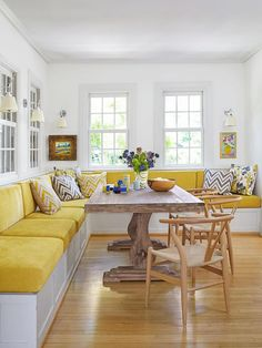 A banquette with seating for 10, built-in storage and topped with stain-resistant, chenille-like cushions. The seating extends way beyond the eating area, which makes the spot a nice lounging place for reading, too.