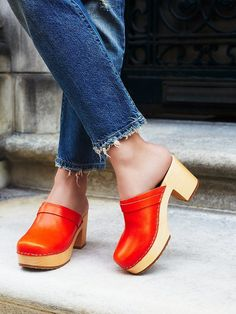 Comfort and style, along with brilliantly bright tangerine, combine in a pair of clogs that were made for strutting the streets. Wooden Sandals, Wooden Clogs, Women's Shoes, Shoes Sneakers, Shoes For School, Womens Golf Shoes, Italian Shoes, Unique Shoes, Clearance Shoes