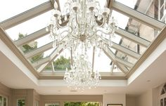Garden room lounge Stunning chandeliers hang from a contemporary orangery roof lantern x Westbury Garden Rooms. Paper Lantern Chandelier, Cardboard Chandelier, Bronze Chandelier, Diy Chandelier, Lanterns, Chandeliers, Lantern Roof Light, Orangery Roof, Conservatory Dining Room