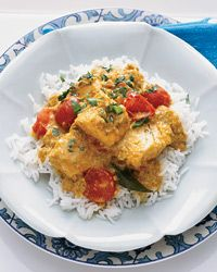 Indian Coconut Fish Curry | Contributed By: Anya Von Bremzen | Inspired by the cooking of the Malabar coast, this fish curry is tremendously flavorful, thanks to tamarind, coconut, garlic and ginger. Kingfish (a type of mackerel) is traditional, but this recipe calls for salmon, whose richness is delectable with the complex spices. | From: foodandwine.com