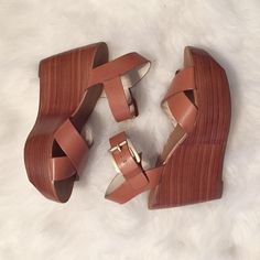 "Michael Kors Wedge Sandals Worn once and in great condition! ✨ cognac Michael Michael Kors wedge sandals. Size 6.5. Real leather! 4"" heel, 2"" platform! MICHAEL Michael Kors Shoes Wedges"