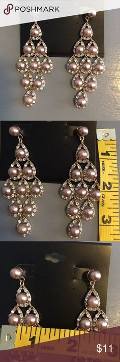 New Champagne Pearl and Crystal Dangle Earrings Faux champagne colored pearls and clear rhinestones make your ears sparkle for that special event. See pics for complete measurements. Please see my closet for more new and gently preowned items. Jewelry Earrings