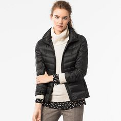 This warm down jacket is incredibly thin and lightweight. The outer lining resists water, and water-repellant thread prevents moisture from entering through seams. We gave the front, back, sides and arms different quilt stitches for an attractive design and feminine silhouette. The edges are reinforced for durability. A high collar and elastic at the cuffs and waist keep out cold wind. Carries easily in its compact pouch.<br><br> • Maximum heat retention without the bulk <br>• Stand collar…