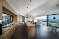 light, open kitchen with wood facade