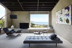 Large picture windows in every room connect occupants to Pacific Ocean vistas. #realestate #forsale #beachhouse #honolulu #hawaii #livingroom