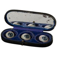 Three Glass Eyes in their Storage Box | From a unique collection of antique and modern curiosities at https://www.1stdibs.com/furniture/more-furniture-collectibles/curiosities/