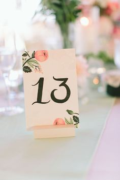 Table Numbers by Rifle Paper Co. See the wedding on SMP: http://www.StyleMePretty.com/tri-state-weddings/2014/03/06/summer-wedding-at-bonnet-island-estate/ Photography: Maggie Harkov