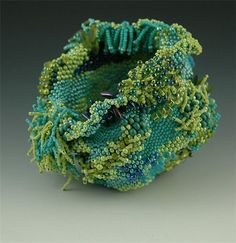 """""""The Reef"""" : Freeform peyote stitched vessel done in numerous sizes and shapes of seed beads.  The fringe and embellishments took longer to make than the base structure.  It reminds me of  something you would find on a reef."""