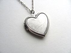 Silver heart locket necklace on antiqued silver chain, photo locket