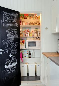 A pantry big enough to fit food and hide the micro oven and recycling bins.