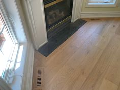 Seamless vents and fireplace frame Engineered Hardwood Flooring, Hardwood Floors, Fireplace Frame, Condominium, Plank, Tile Floor, Concrete, Cottage, Home