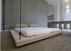 hanging bed. concrete wall