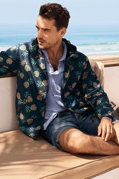 Navy blue windbreaker with pineapple print, paired with a blue button-down cotton shirt.   H&M For Men
