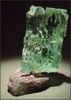 A Large Green Beryl Crystal. There are differing opinions on what is green beryl vs. emerald, but most experts agree an emerald has to contain chromium or vanadium. Green beryl is much more common than emerald. Cool Rocks, Beautiful Rocks, Minerals And Gemstones, Rocks And Minerals, What Is Green, Mineral Stone, Stones And Crystals, Gem Stones, Rocks And Gems